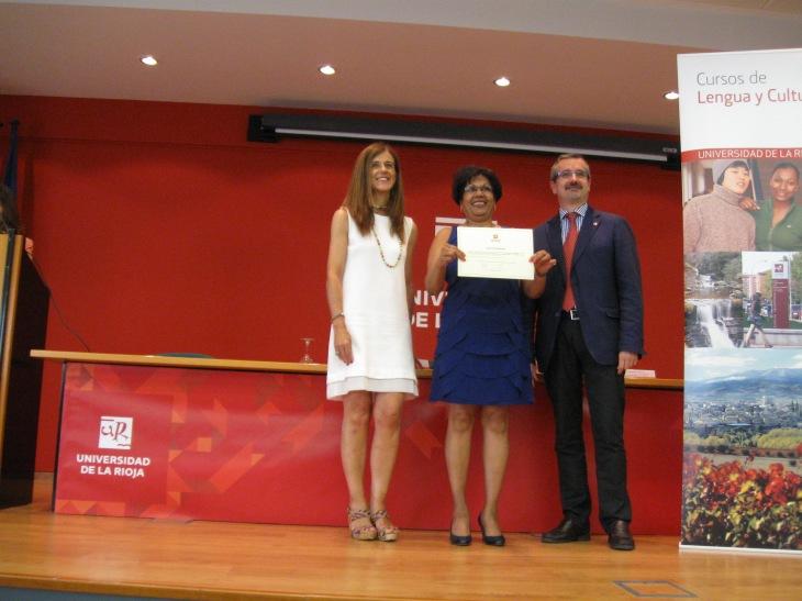Zalina with Diploma on Graduation Day