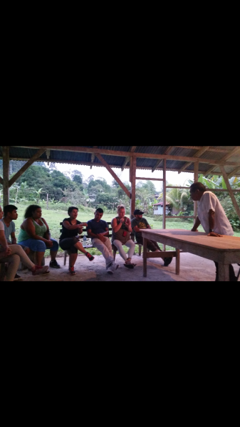 listening to a speech about the history of the BriBri tribe by one of the Student's (Gean) uncle.